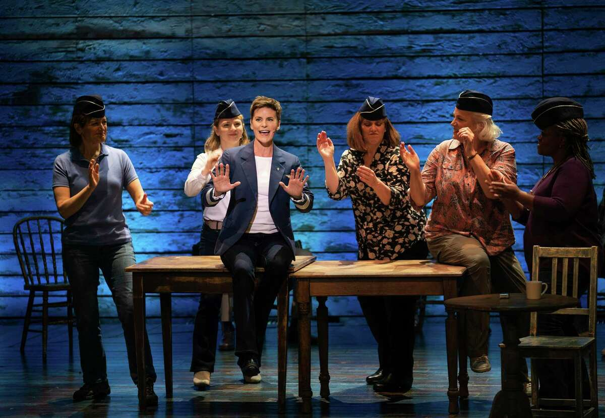 """This image released by Apple TV+ shows Jenn Colella, foreground, in a scene from """"Come From Away,"""" premiering Sept. 10."""