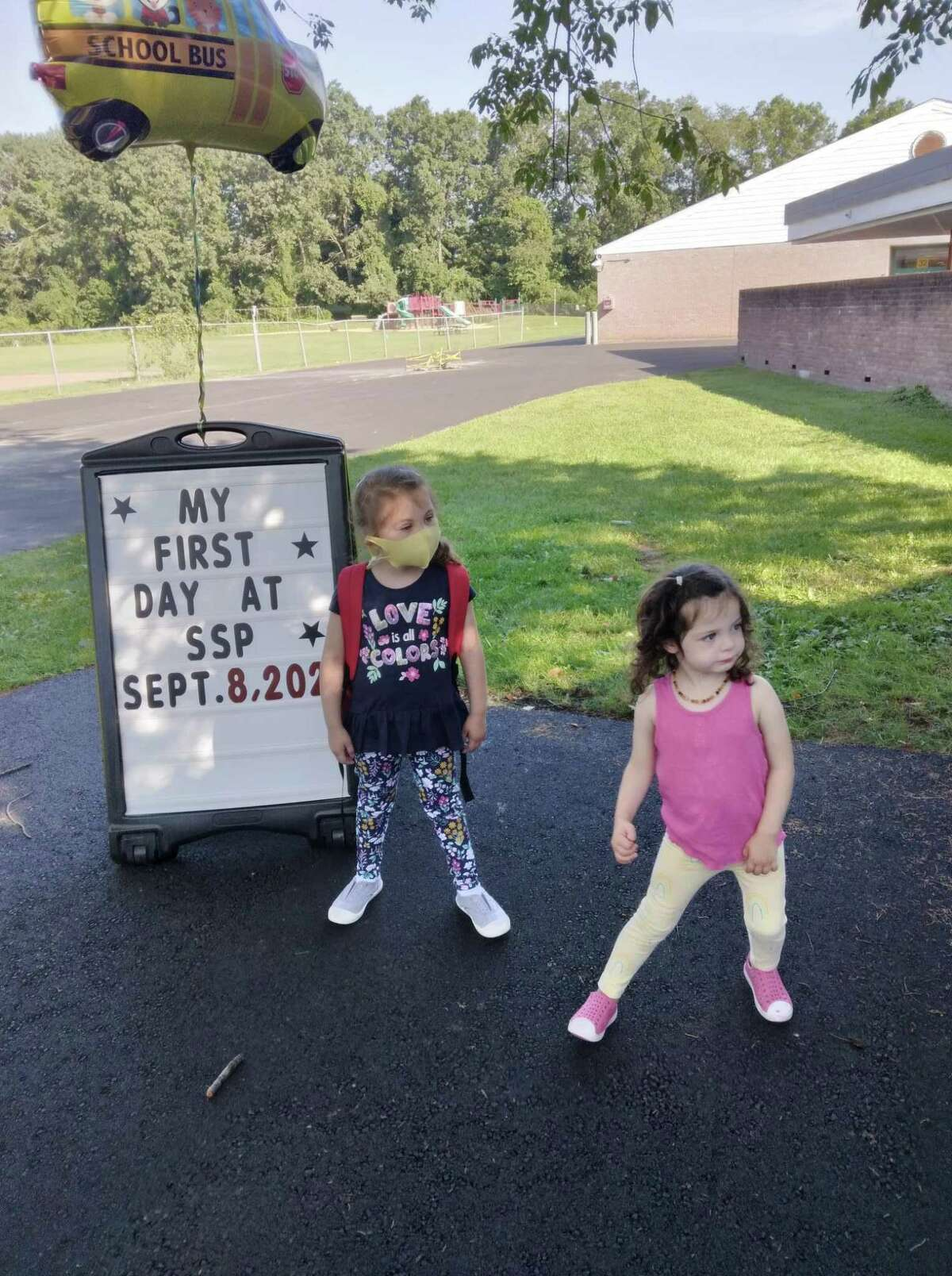 Dillon Untracht, 4, and Rebel Untracht, 2, pose for pictures outside Stepping Stones Preschool in Westport on the first day of school, Sept. 8, 2021.