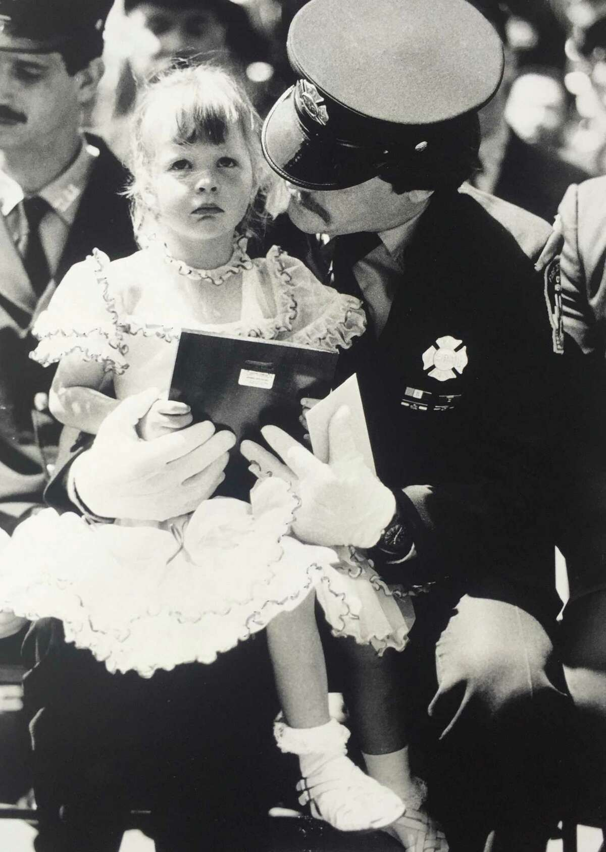 A dated photograph of New York City firefighter Chris Blackwell with one of his daughters, Alexandra. Blackwell died in the World Trade Center attacks on Sept. 11, 2001.