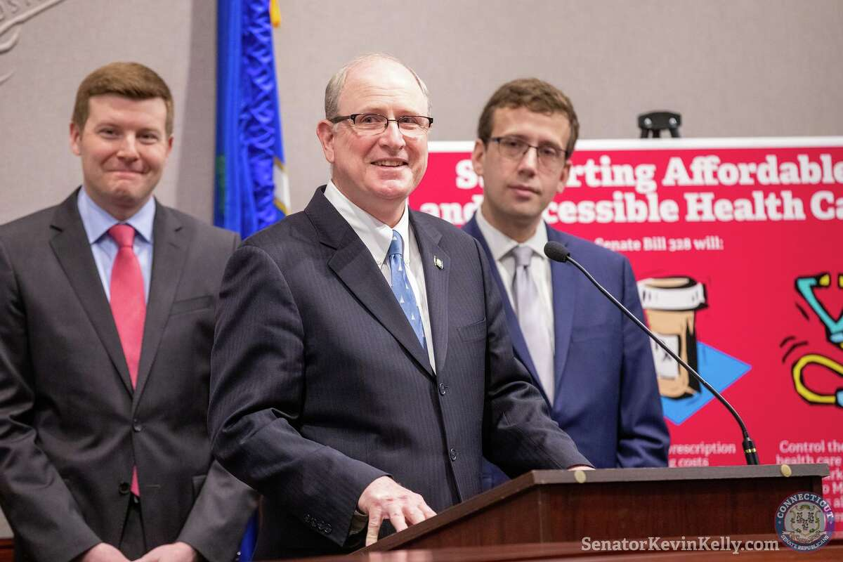 State Senate Minority Leader Kevin Kelly, R-Stratford, center, opposes a public health plan put forward by Democrats, including Rep. Sean Scanlon, D-Guilford, left, and Sen. Matthew Lesser, D-Middletown. The three are shown at an event for a related measure that they all supported.