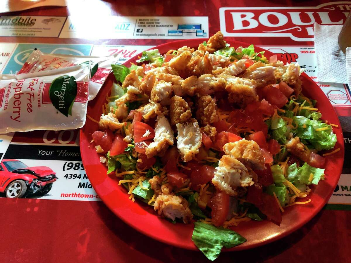For my lunch at The Boulevard Lounge, I went with the chicken tenders salad, topped with raspberry vinaigrette. There is a grilled chicken option for the more health-conscious. (Victoria Ritter/vritter@mdn.net)