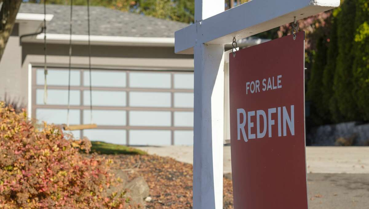 SEATTLE, WA - OCTOBER 31: A Redfin real estate yard sign is pictured in front of a house, on October 31, 2017, that recently sold, in Seattle, Washington. Seattle has been one of the fastest and most competitive housing markets in the United States throughout 2017. (Photo by Stephen Brashear/Getty Images for Redfin)