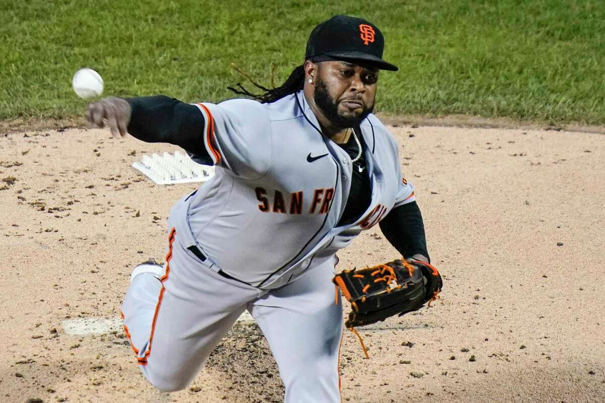 San Francisco Giants' Johnny Cueto delivers a pitch during the second inning of the team's baseball game against the New York Mets on Wednesday, Aug. 25, 2021, in New York. (AP Photo/Frank Franklin II)