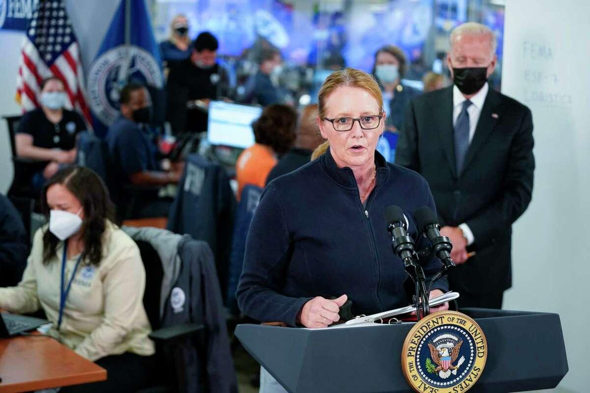 President Joe Biden listens as FEMA Administrator Deanne Criswellspeaks at theNational Response Coordination Center at FEMA headquarters, Sunday, Aug. 29, 2021, in Washington. (AP Photo/Manuel Balce Ceneta)