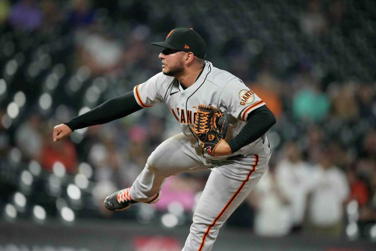 San Francisco Giants relief pitcher Kervin Castro (76) in the ninth inning of a baseball game Tuesday, Sept. 7, 2021, in Denver. The Giants won 12-3. (AP Photo/David Zalubowski)