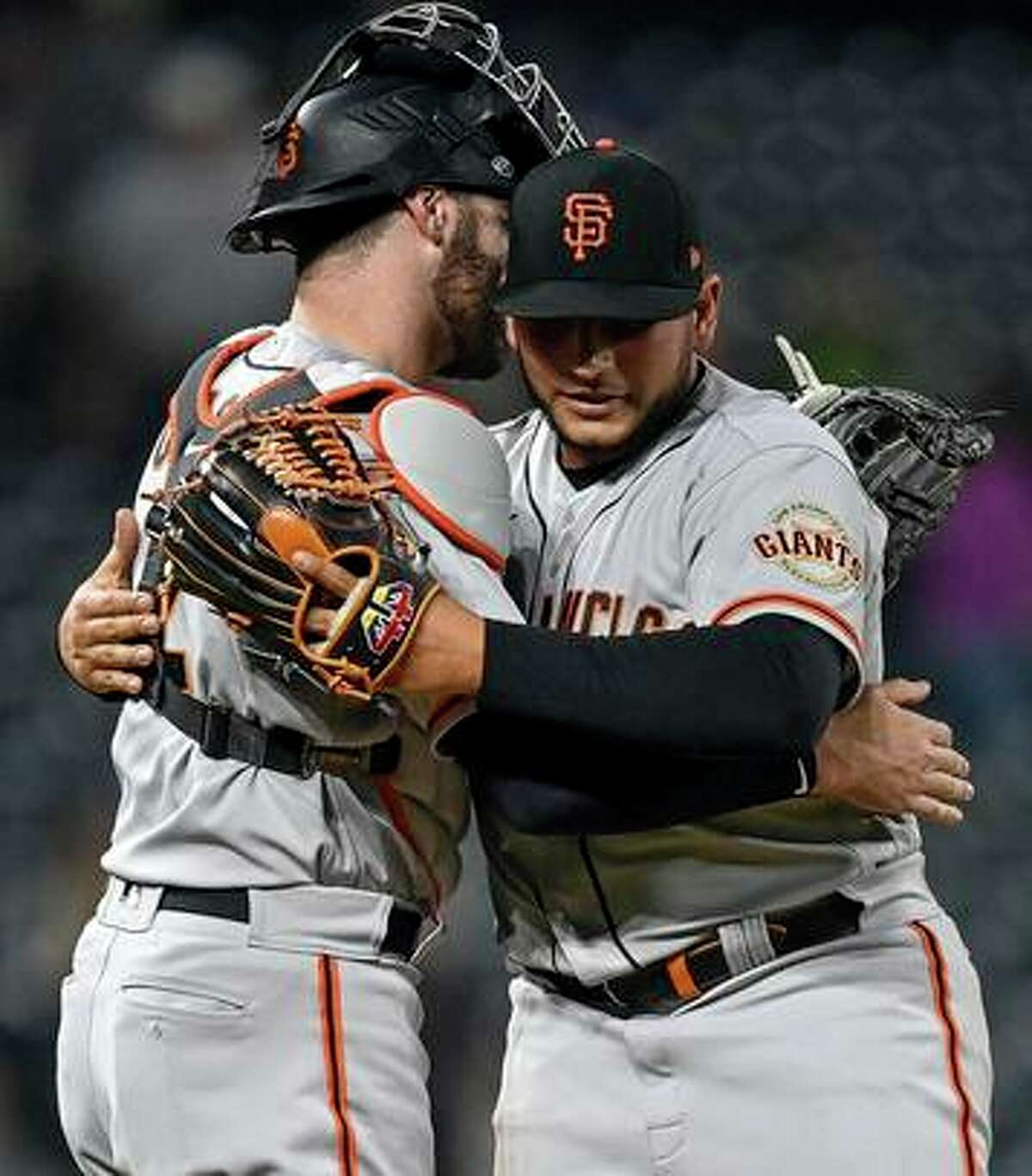DENVER, CO - SEPTEMBER 7: Kervin Castro #76 and Curt Casali #2 of the San Francisco Giants celebrate after a 12-3 win over the Colorado Rockies at Coors Field on September 7, 2021 in Denver, Colorado. (Photo by Dustin Bradford/Getty Images)