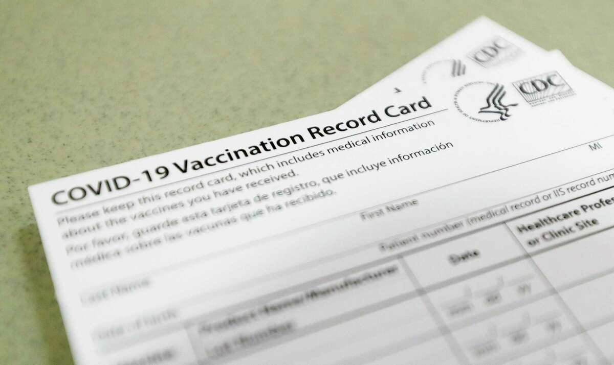 A COVID-19 vaccination record cards are seen at one of Montgomery County's COVID-19 vaccination sites. Montgomery County hospitalizations related to COVID-19 have passed 400 patients as active cases continue to soar.