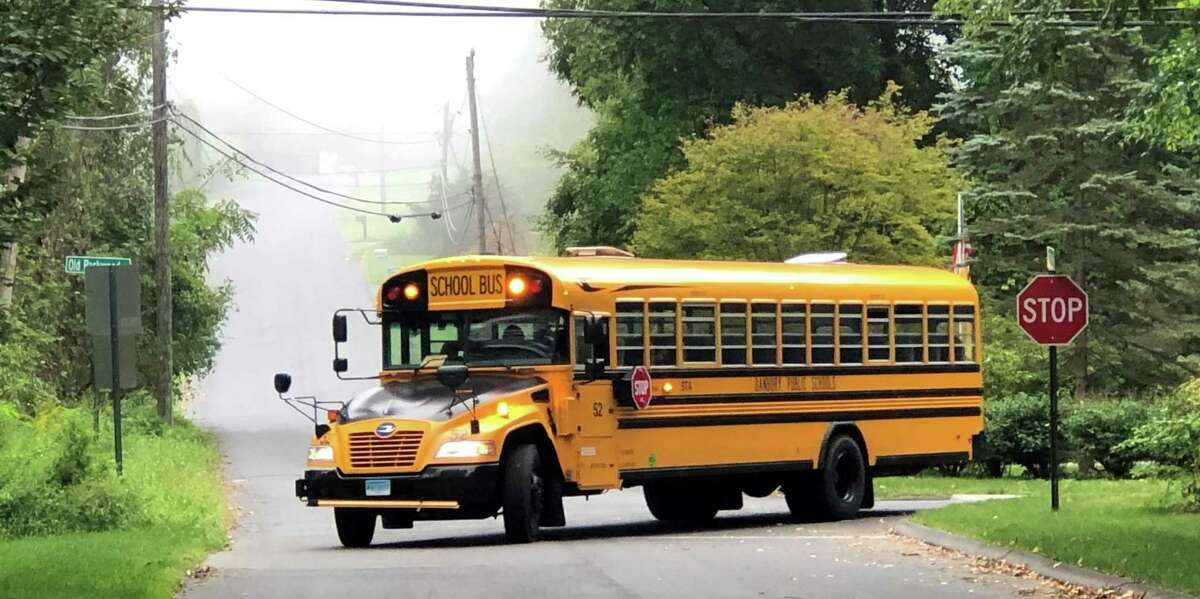 A bus makes its way on Stephanie Drive in New Milford on the first day of school in September 2020.