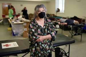 Stamford resident Betsy Henry, 68, poses after donating her 224th pint of blood at Stamford Church of Christ in Stamford, Conn. Wednesday, Sept. 8, 2021. Henry is applying to become the Guinness World Record holder for most blood donated by a woman.