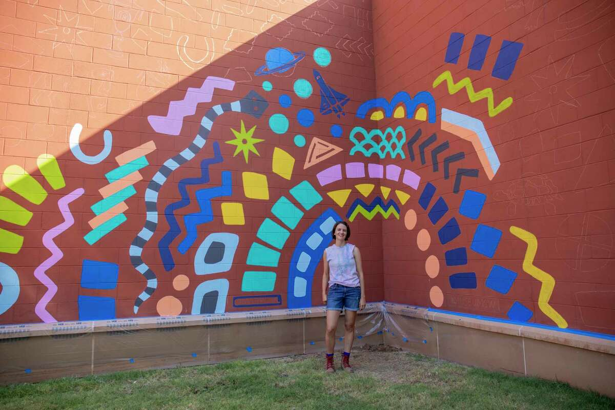 Mari Pohlman poses for a portrait beside a new mural as seen Wednesday, Sept. 8 at the Museum of the Southwest. Pohlman will be painting during the SeptemberFest fundraiser Saturday. She will complete the mural by midday. Jacy Lewis/Reporter-Telegram