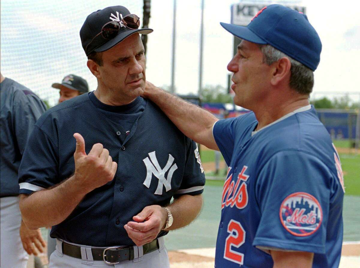 New York Yankees manager Joe Torre, left, chats with New York Mets manager Bobby Valentine, right, before the second game of their three-game Subway Series at Shea Stadium in New York on June 27, 1998.