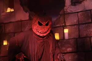 One of the killer pumpkins who greet you as you walk through the gates to Halloween Horror Nights.
