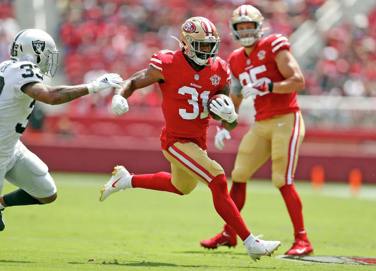 Running back Raheem Mostert and tight end George Kittle, seen in a preseason against the Raiders on Aug. 29, combined for 1,328 yards of offense last season; each played eight games.