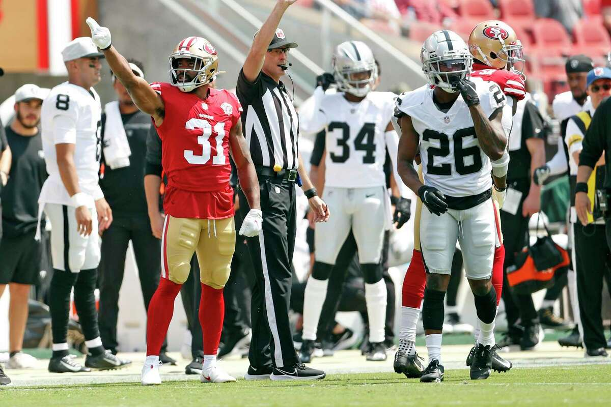 San Francisco 49ers' Raheem Mostert signals 1st down on a 1st quarter touchdown drive against Las Vegas Raiders during Niners 34-10 in NFL preseason game at Levi's Stadium in Santa Clara, Calif., on Sunday, August 29, 2021.