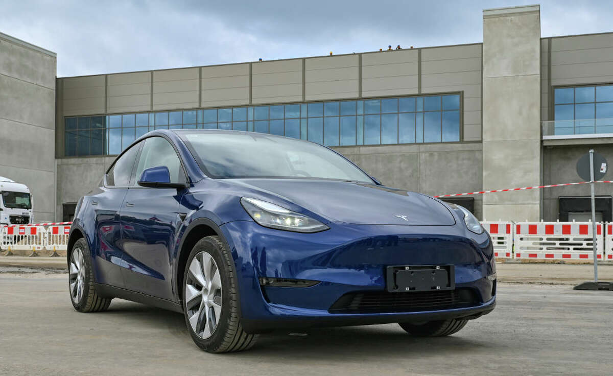 A Tesla Model Y electric vehicle stands at the construction site of the Tesla Gigafactory Berlin-Brandenburg.
