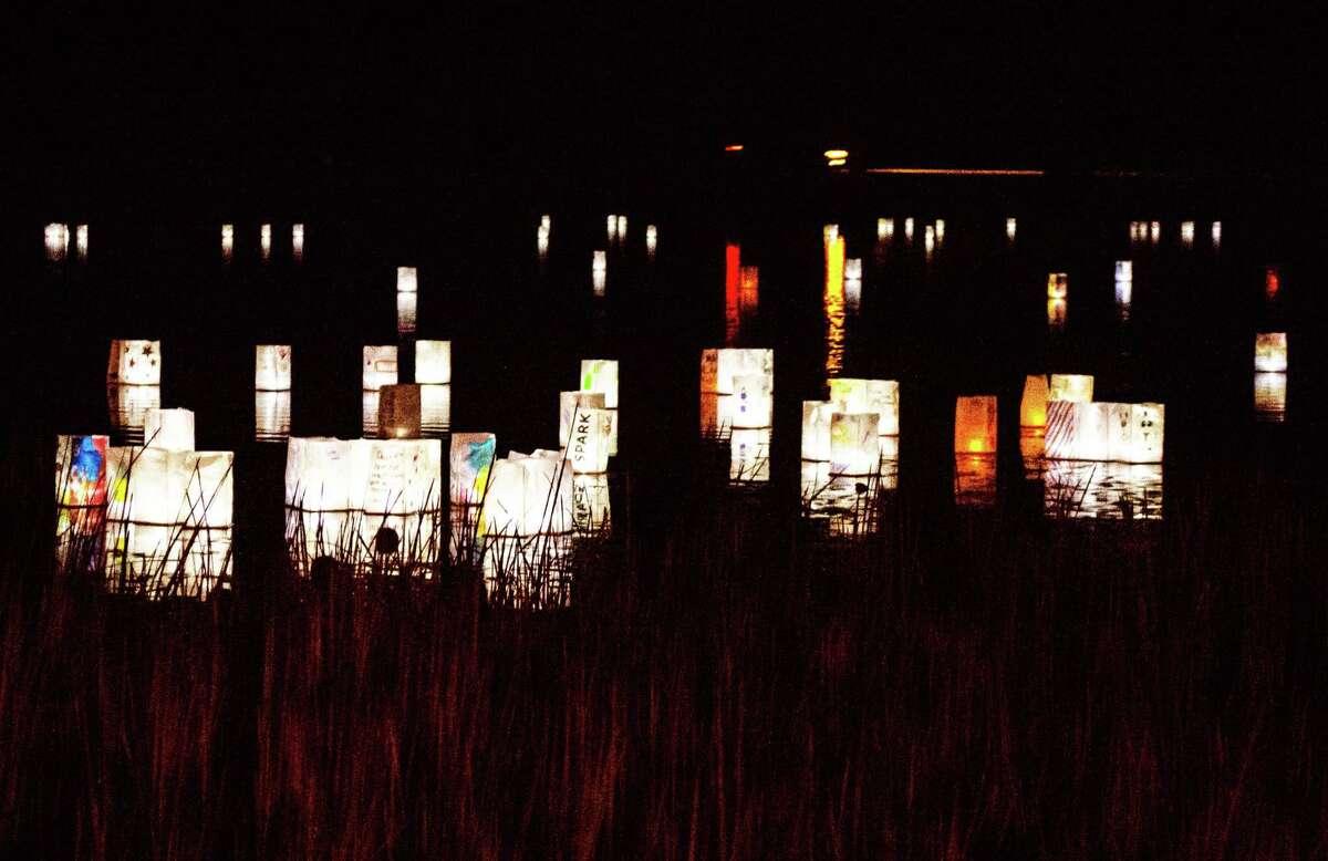 Lanterns float in Plattwood Park Pond during the 2020 water lantern celebration in Deep River.