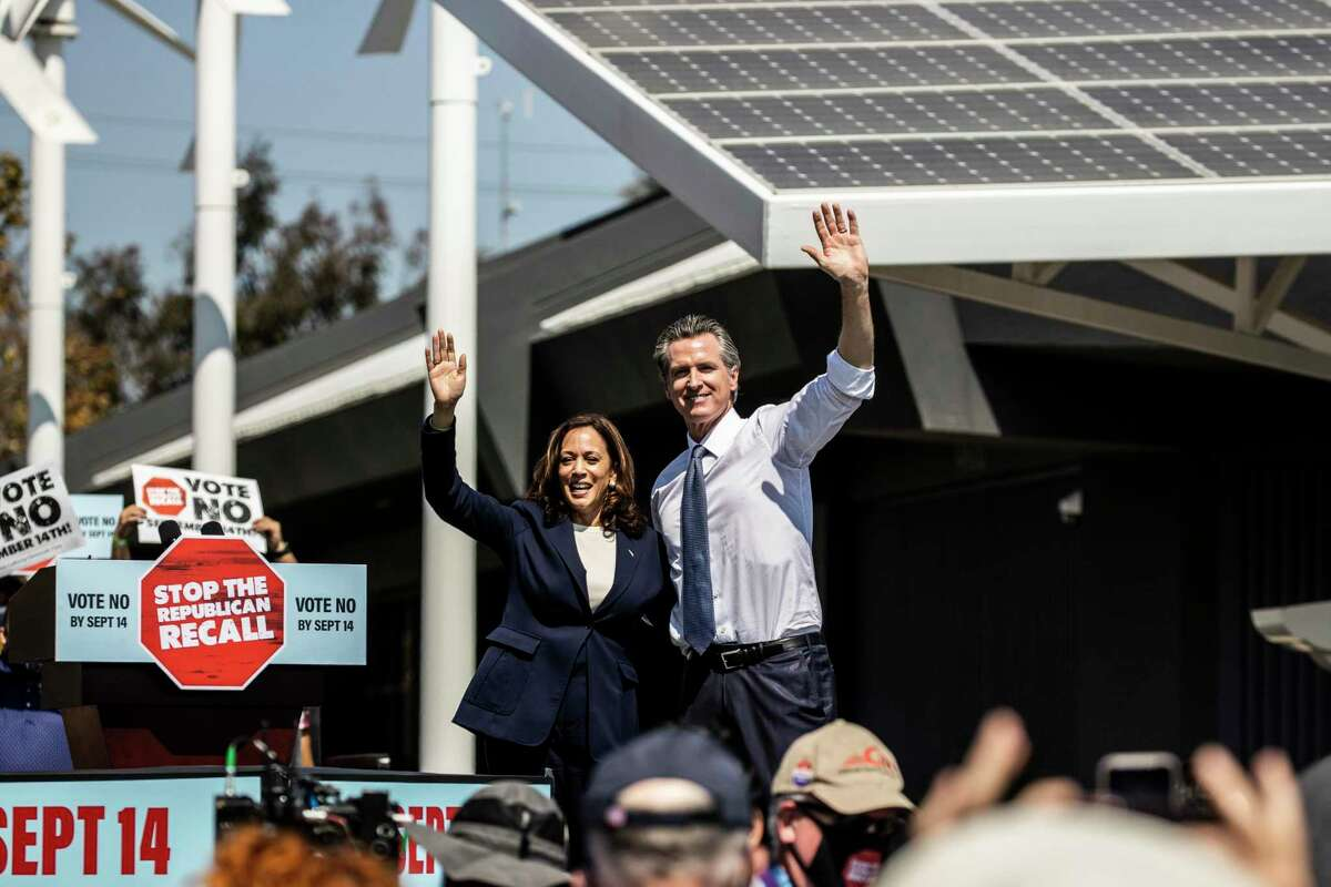 Vice President Kamala Harris and California Governor Gavin Newsom stare the stage during a campaign visit against the upcoming gubernatorial recall election at the IBEW-NECA Joint Apprenticeship Training Center in San Leandro, Calif. on Wednesday, Sept. 8, 2021.