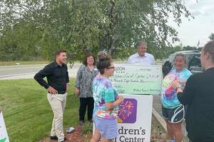 The Midland Board of Realtors (MBOR) presented a donation to the Children's Grief Center of the Great Lakes Bay Region on Tuesday. TheCenter's Executive Director Camille Gerace Nitschky (pictured right, wearing tie-dye) saidthe funding might be used to purchase a portable putt-putt golf set for support group members. She said it could also be used for a fundraising effort to help cover operating costs of the center.(Tess DeGayner/tess.degayner@hearstnp.com)