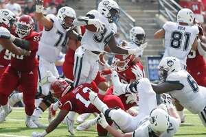 Connecticut running back Kevin Mensah goes up high against Fresno State during the first half of an NCAA college football game in Fresno, Calif., Saturday, Aug. 28.