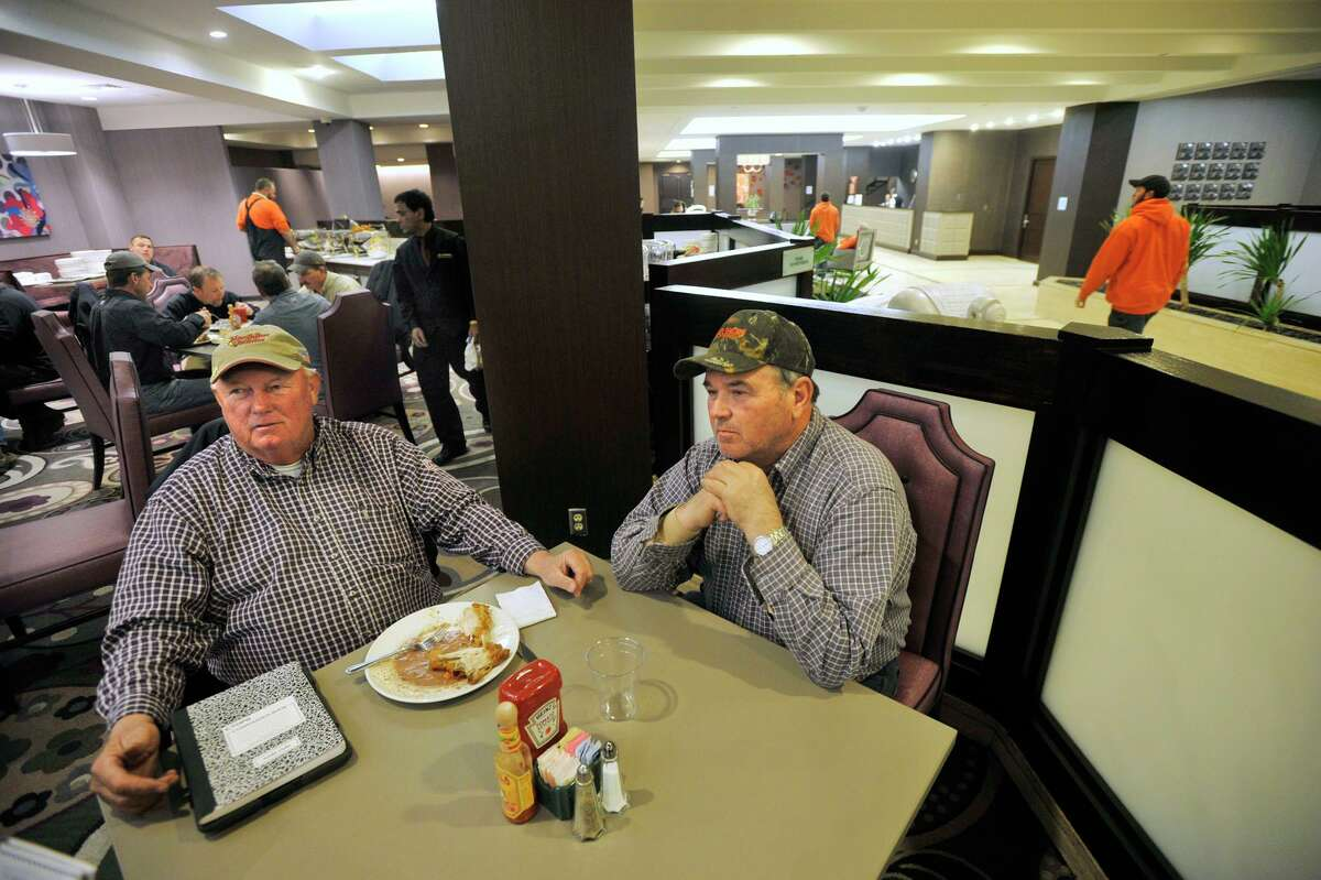 Utility contractors Jim Radley, left, and Don Allen sit in the Crowne Plaza Danbury restaurant on Thursday, Nov. 8, 2012.