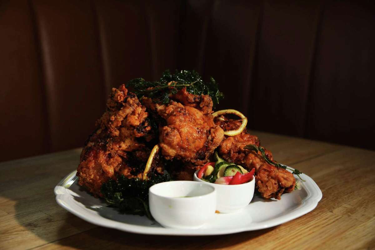 The fried chicken includes Calabrian honey, house pickles and basil aioli.