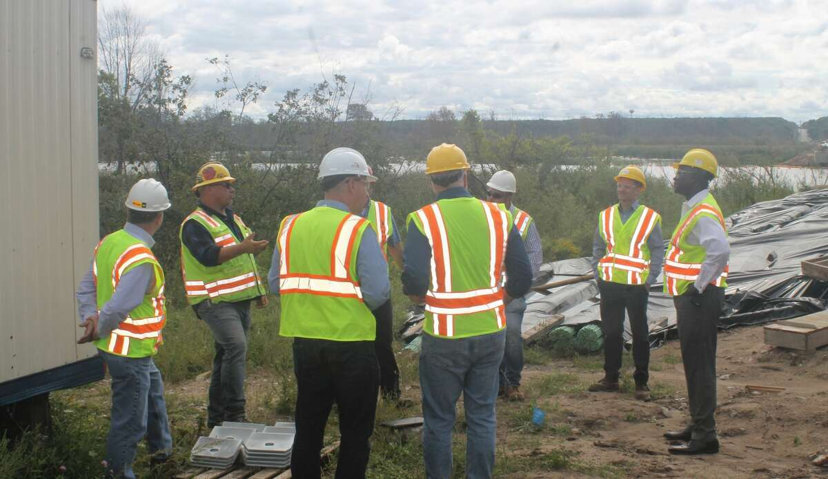 Michigan Department of Transportation director Paul Ajegba (right) visits the M-55 bridge project in Manistee Township on Wednesday to get an update on the project.