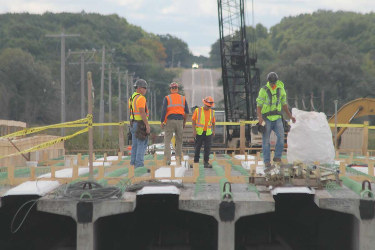 Work is done on the center span of the M-55 bridge project in Manistee Township on Wednesday.