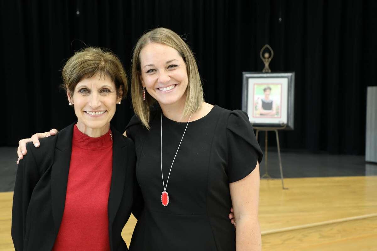 Educator Jackie Caffey, left, and Principal Tina McCorkle attend a dedication event for Caffey Junior High School Aug. 29.