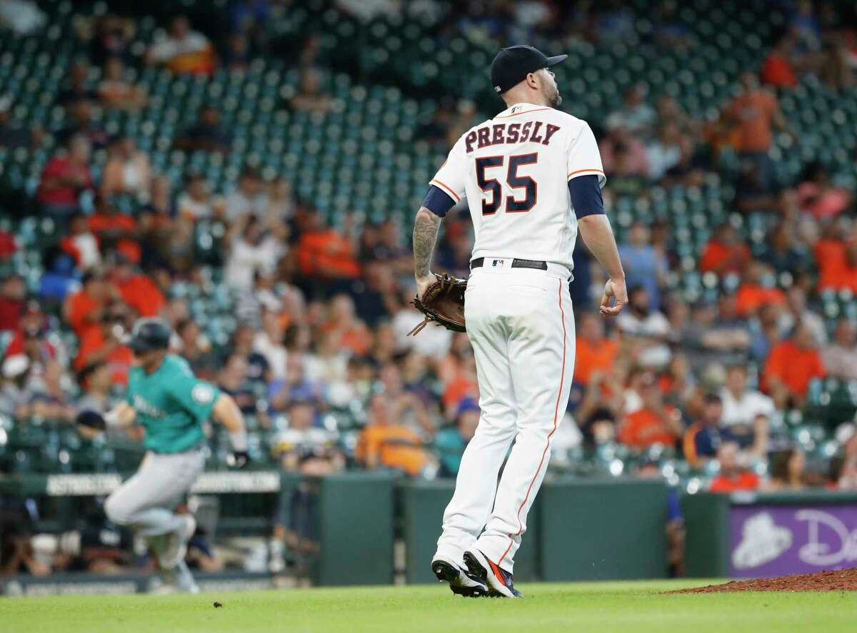 Astros closer Ryan Pressly watches the go-ahead hit by the Mariners' Jose Marmolejos go through the infield during a four-run ninth inning in the Astros' 8-5 loss Wednesday at Minute Maid Park.