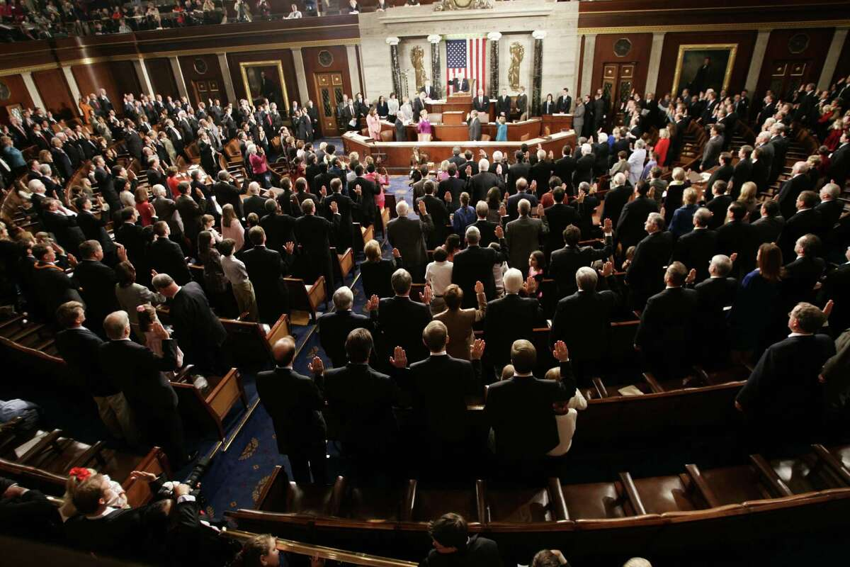 House members of the 109th Congress take their oath from House Speaker Dennis Hastert of Ill., on the floor of the House, Tuesday, Jan. 4, 2005 on Capitol Hill.