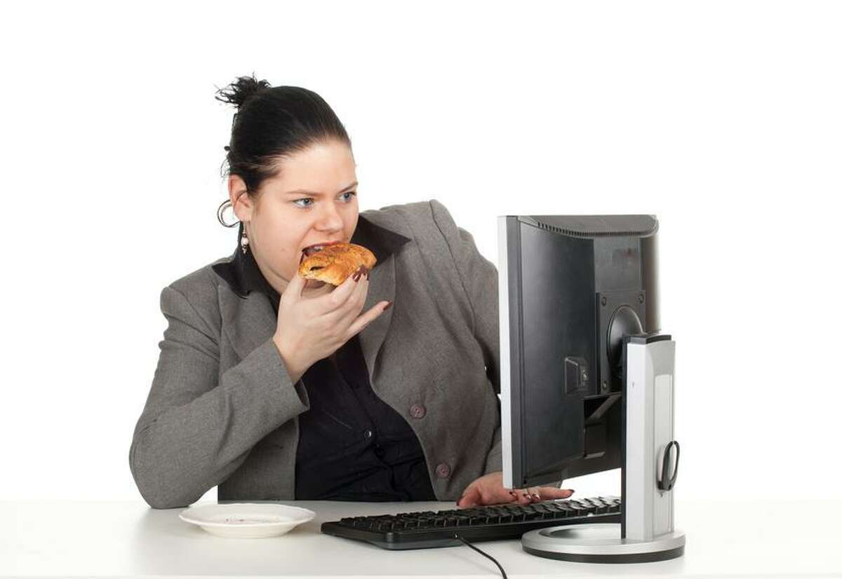 Overweight eating and working in a computer