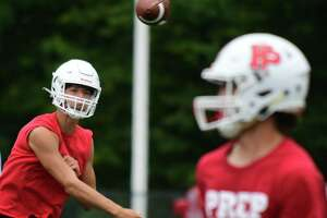 Fairfield Prep quarterback Connor Smith throws to a receiver during The Grip It and Rip It 7-on-7 tournament in July in New Canaan.