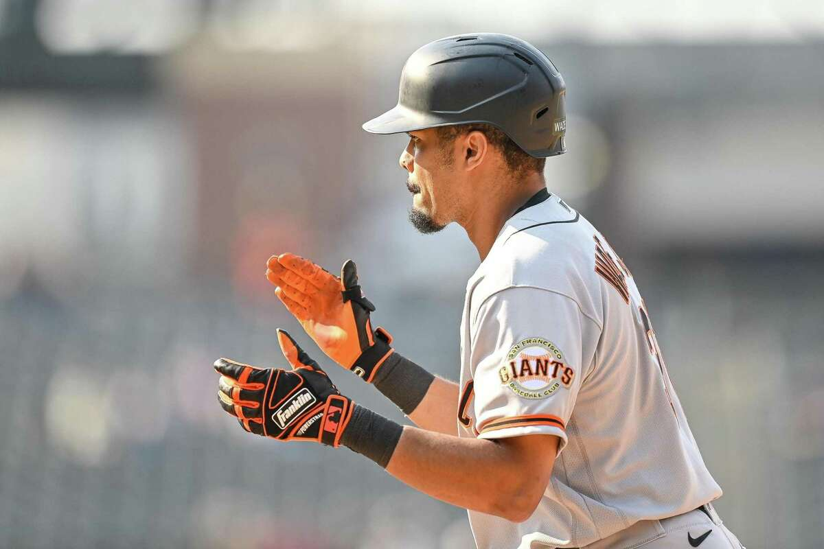 DENVER, CO - SEPTEMBER 8: LaMonte Wade Jr. #31 of the San Francisco Giants claps after hitting a two-run go-ahead single in the ninth inning of a game against the Colorado Rockies at Coors Field on September 8, 2021 in Denver, Colorado. (Photo by Dustin Bradford/Getty Images)