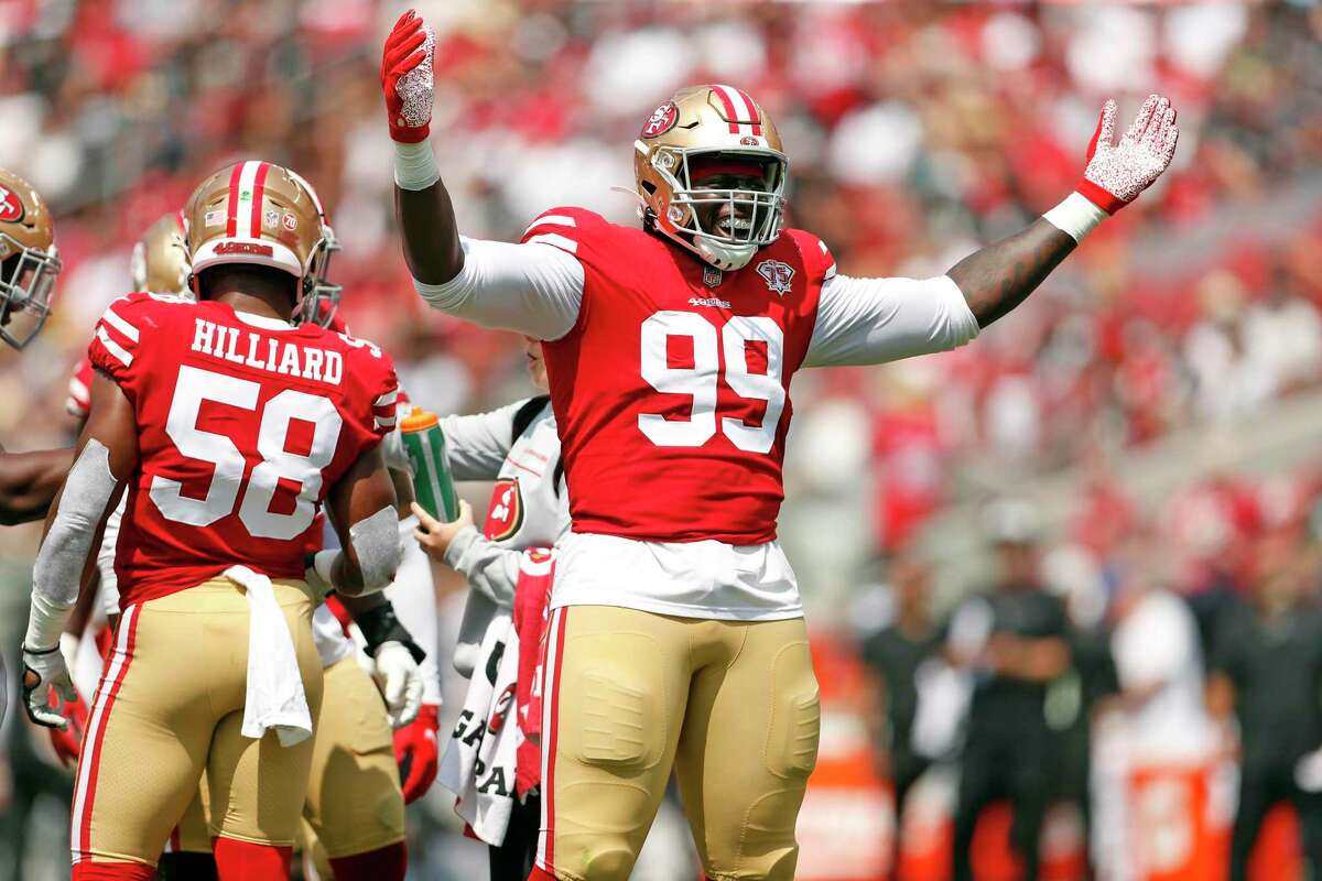 San Francisco 49ers' Javon Kinlaw interacts with the crowd in 2nd quarter of 34-10 win over Las Vegas Raiders during NFL preseason game at Levi's Stadium in Santa Clara, Calif., on Sunday, August 29, 2021.