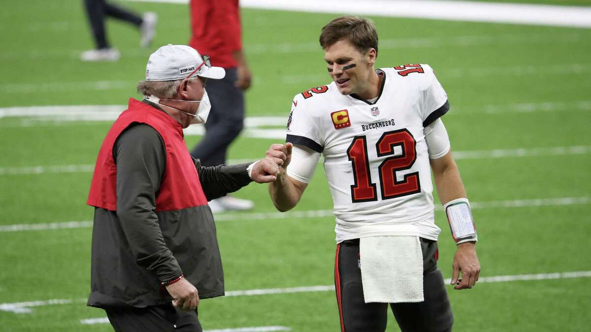 Tom Brady and coach Bruce Arians begin the Buccaneers' championship defense Thursday against the Cowboys in Tampa.