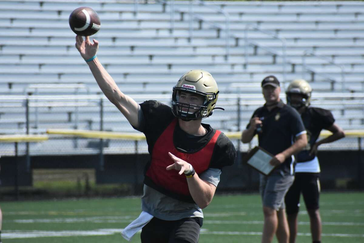 Hand quarterback Patch Flanagan throws against Greenwich during a joint practice on Aug. 24, 2021.