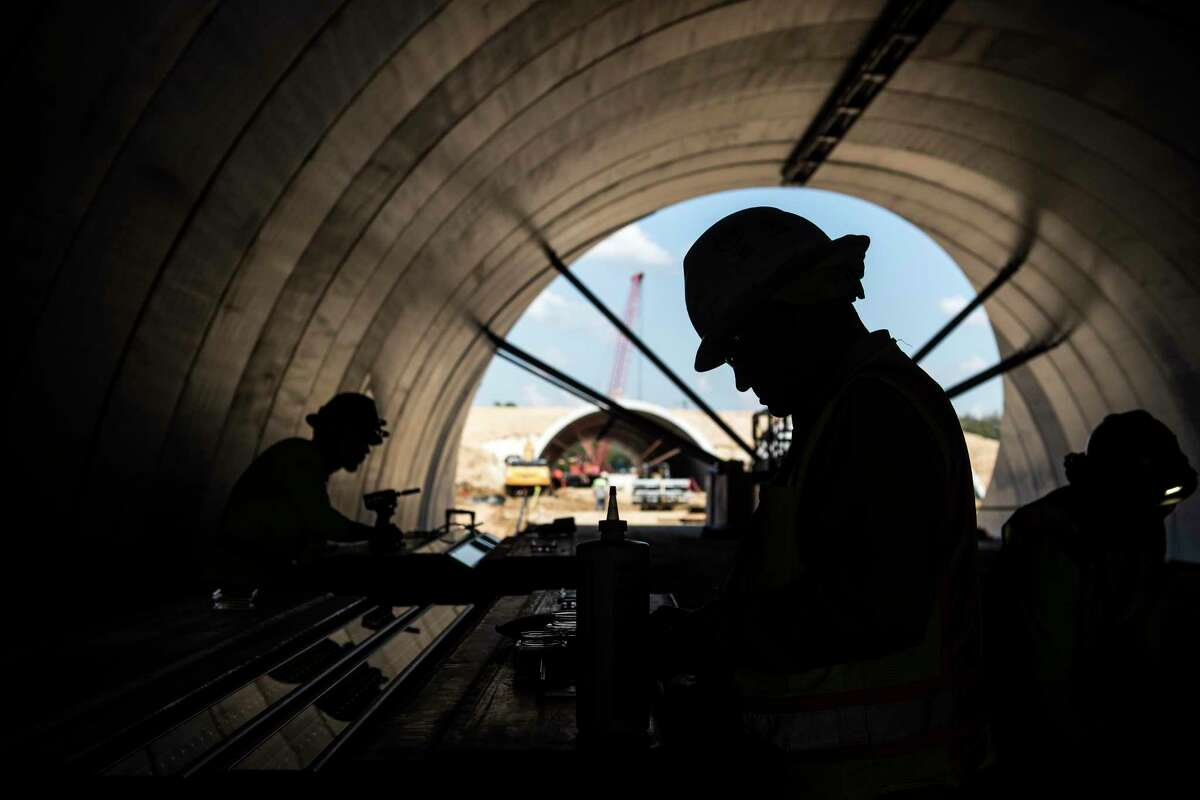 Workers put together lighting inside a tunnel as construction continues on the Land Bridge and Prairie project at Memorial Park Wednesday, Sept. 8, 2021 in Houston. The nearly 100-acre project will reunite the north and south sides of the Memorial Park by creating a land bridge over Memorial Drive to create a new community space for park users.