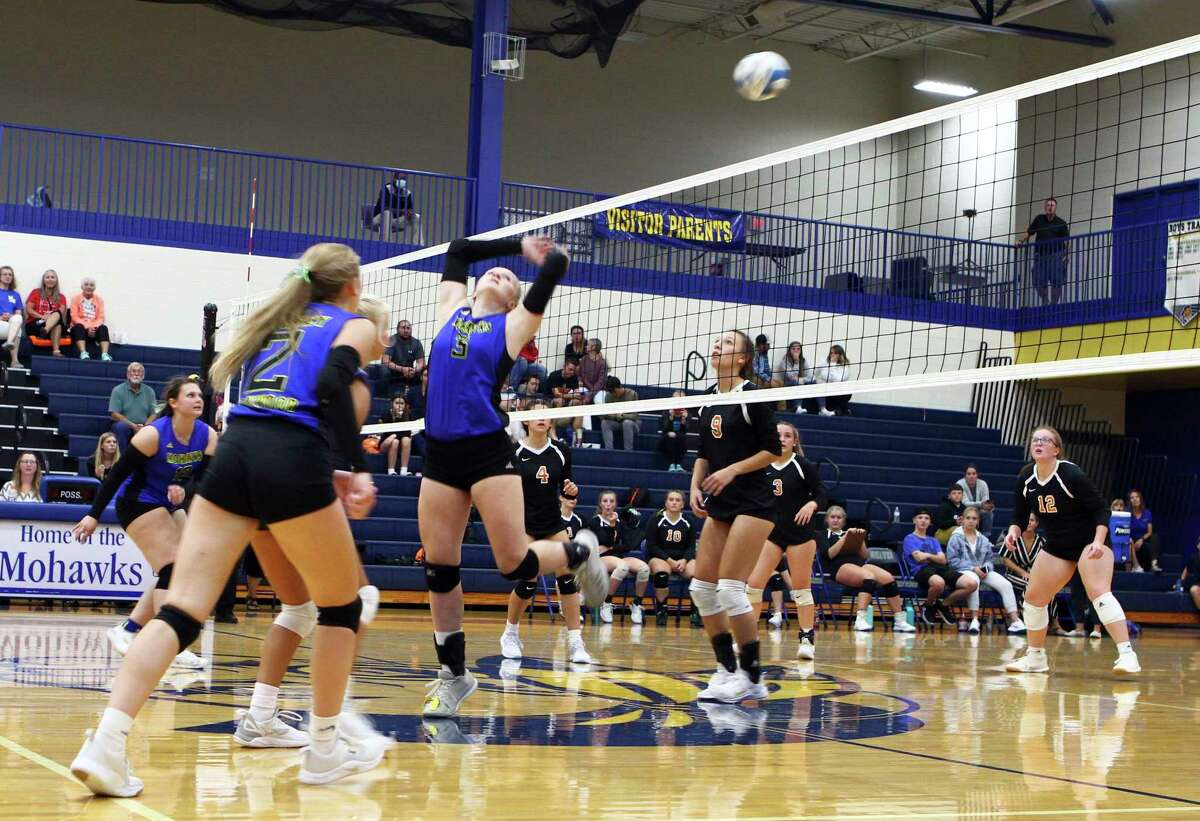 Morley Stanwood senior Madison Garbow stretched to knock the ball over the net during the Mohawks' victory over White Cloud Wednesday night. (Pioneer photo/Joe Judd)