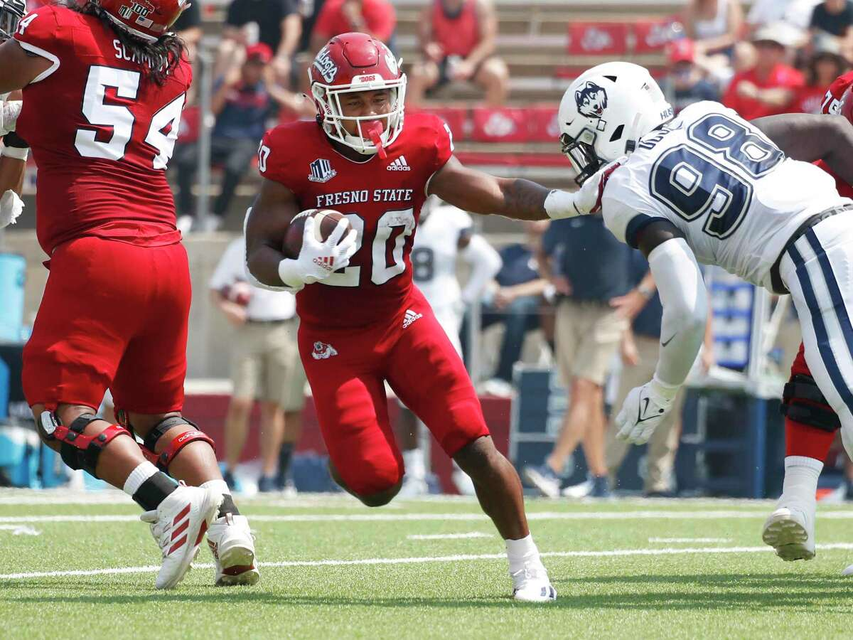Fresno State running back Ronnie Rivers drives for yards against Connecticut during the first half of an NCAA college football game in Fresno, Calif., Saturday, Aug. 28, 2021. (AP Photo/Gary Kazanjian)