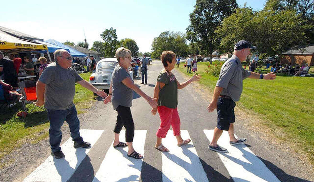 """Guests walk a mock Abbey Road during the 2019 """"When I'm 64 Beatles Festival."""" The event was virtual last year, but is making a return from noon to 8:30 p.m. Saturday, Sept. 11, in Prairietown."""