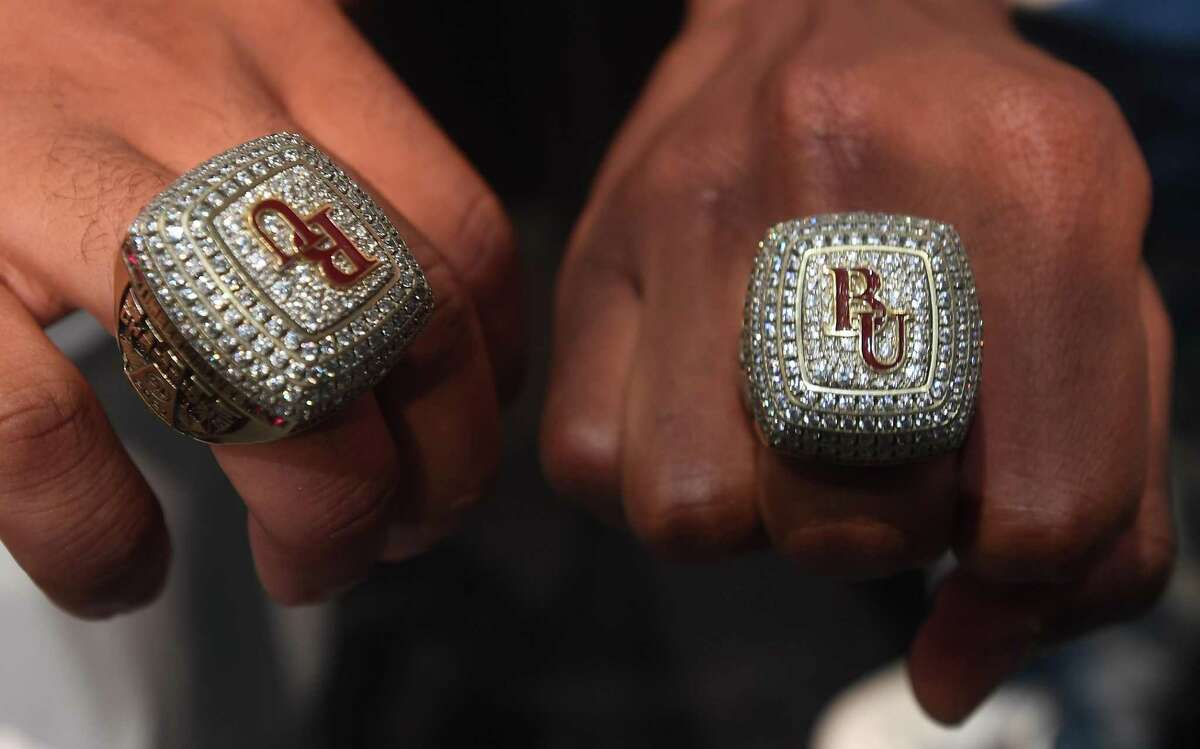 Teammates gather and celebrate backstage after receiving their rings during a special ceremony honoring the Beaumont United state champion basketball team, coaches and staff and presenting them with their champion rings. Photo made Wednesday, September 8, 2021 Kim Brent/The Enterprise