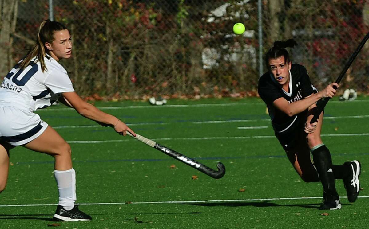 Ridgefield's Julia Carrozza hits the bll past Staples' Jessica Leon during a game in November.