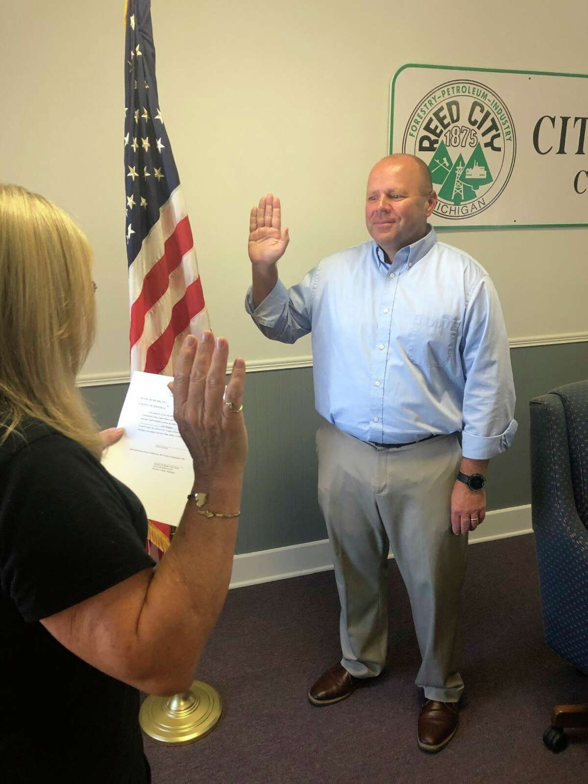 Rich Saladin takes the oath of office as the new city manager for Reed City effective Sept. 1. (Submitted photo)