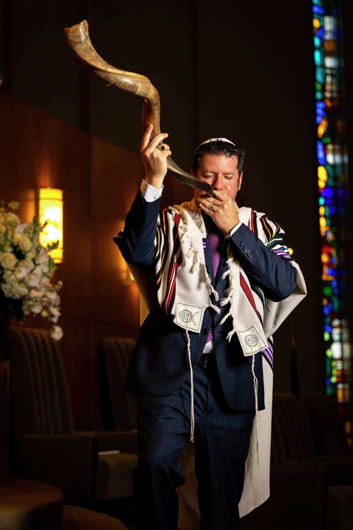 David Scott blows the shofar, a ram's horn that functions as a trumpet and calls Jewish people to worship for the new year at Congregation Beth Israel on Wednesday, Sept. 8, 2021. Scott is the director of lifelong learning and engagement at the synagogue and official shofar blower.