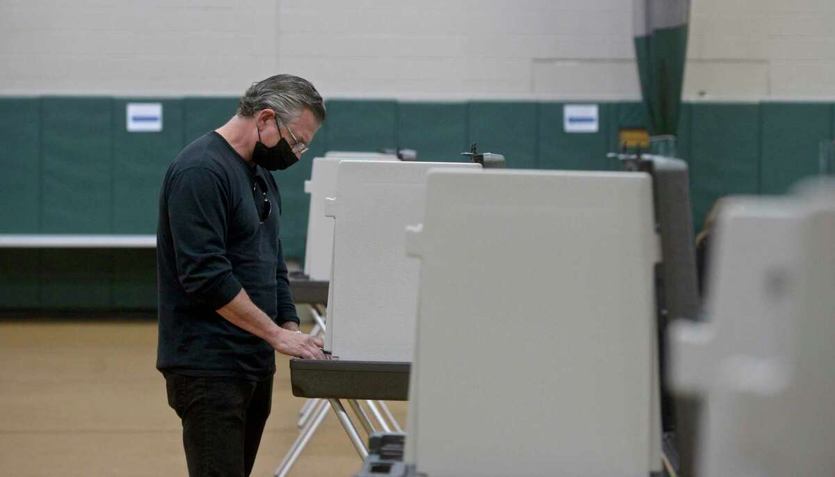 Charles Cilo, of Redding, votes in the Redding budget referendum at the Redding Community Center, Tuesday, May 4, 2021, in Redding, Conn.