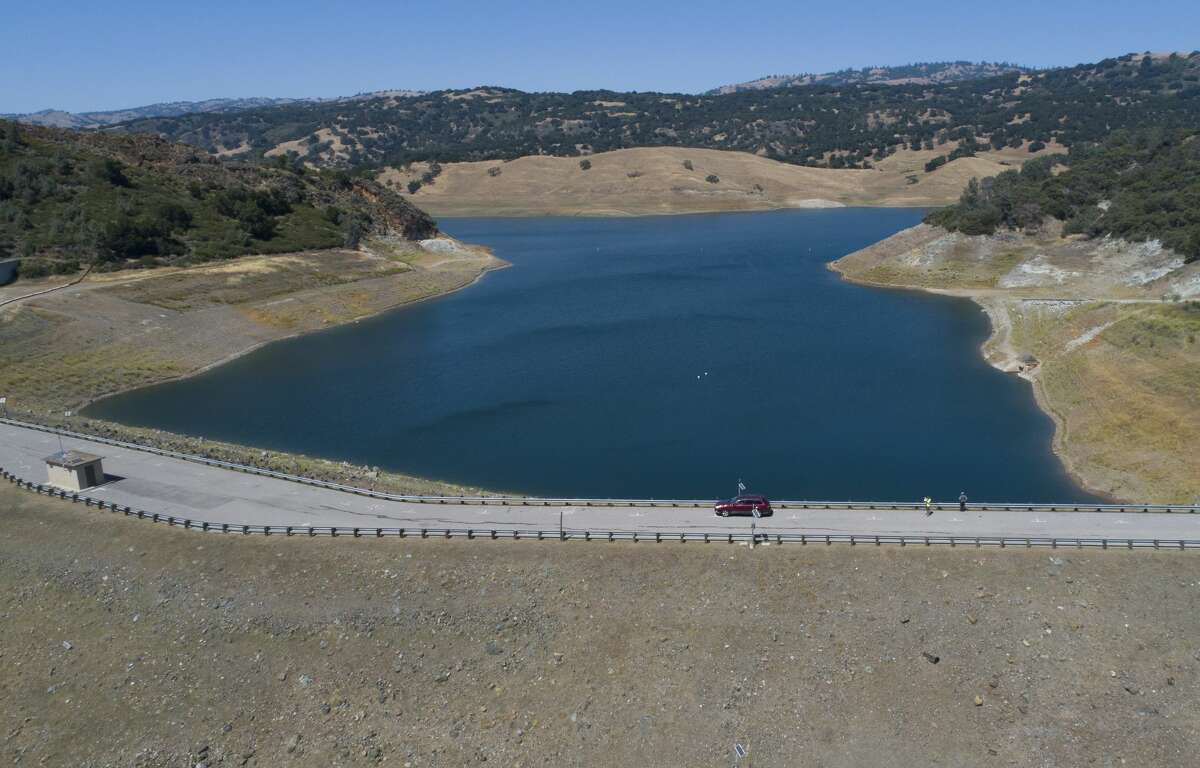 The Anderson Dam in Anderson Lake County Park is seen from this drone view in Morgan Hill, Calif., on Thursday, May 28, 2020. Federal dam regulators ordered Anderson Reservoir, the largest reservoir in Santa Clara County, to be completely drained because of earthquake collapse risk.
