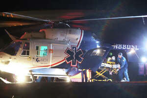 An ARCH Air Medical Services, Inc., helicopter ambulance unloads equipment on the landing pad late Wednesday night at Alton Memorial Hospital to pick up one of three people injured by gunfire on 700 Oakwood Avenue in Alton shortly after 11 p.m. Two additional helicopters also landed at St. Anthony's Medical Center in Alton for shooting victims.
