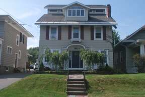 This week's house at 48 Euclid Ave. is in Albany's Buckingham Pond neighborhood and has a surprising amount of space inside and a pool in the back. Built in 1923, the house has been expanded over time to comprise 3,000 square feet of living space, four bedrooms and two and a half bathrooms. Recent improvements include a new furnace in 2018, water heater last year and a poolside patio installed this year. Quartz counters in the updated kitchen and an updated bathroom go nicely with original hardwood floors, trim and molding. There is an electric fireplace in the living room and a recreation room on the third floor large enough for a pool table that has a balcony overlooking the backyard. Taxes: $10,101. List price after a $15,000 reduction: $395,000. Contact listing agent David Fyfe with Bird Realty at 518-321-7161. An open house is scheduled for 12 to 3 p.m. Sunday.
