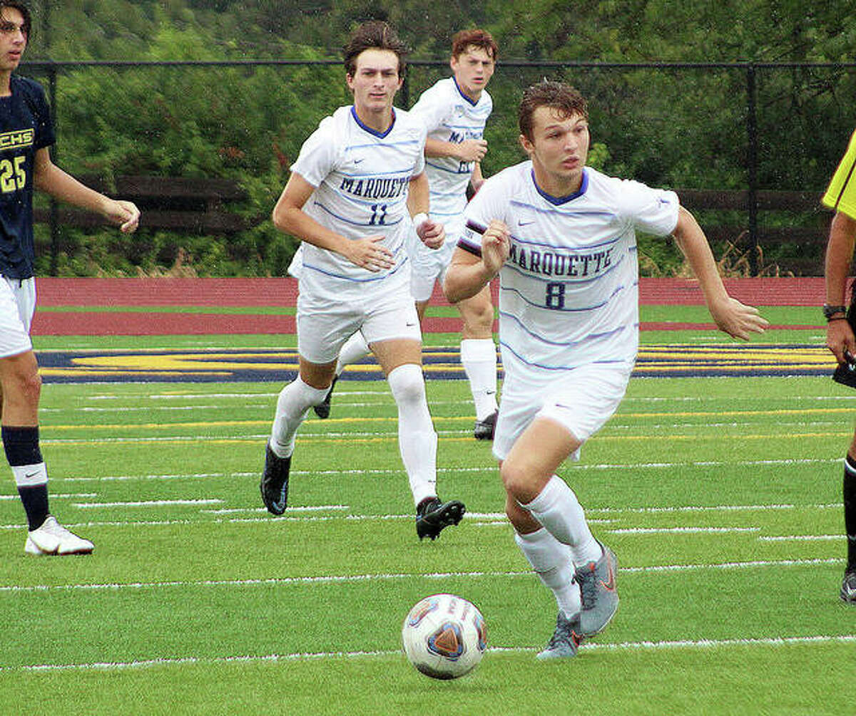 Marquette Catholic High's Dre Davis (8) scored a goal and added a pair of assists in a 6-1 victory Wednesday over Belleville East. He is shown in action last week at Belleville Althoff.