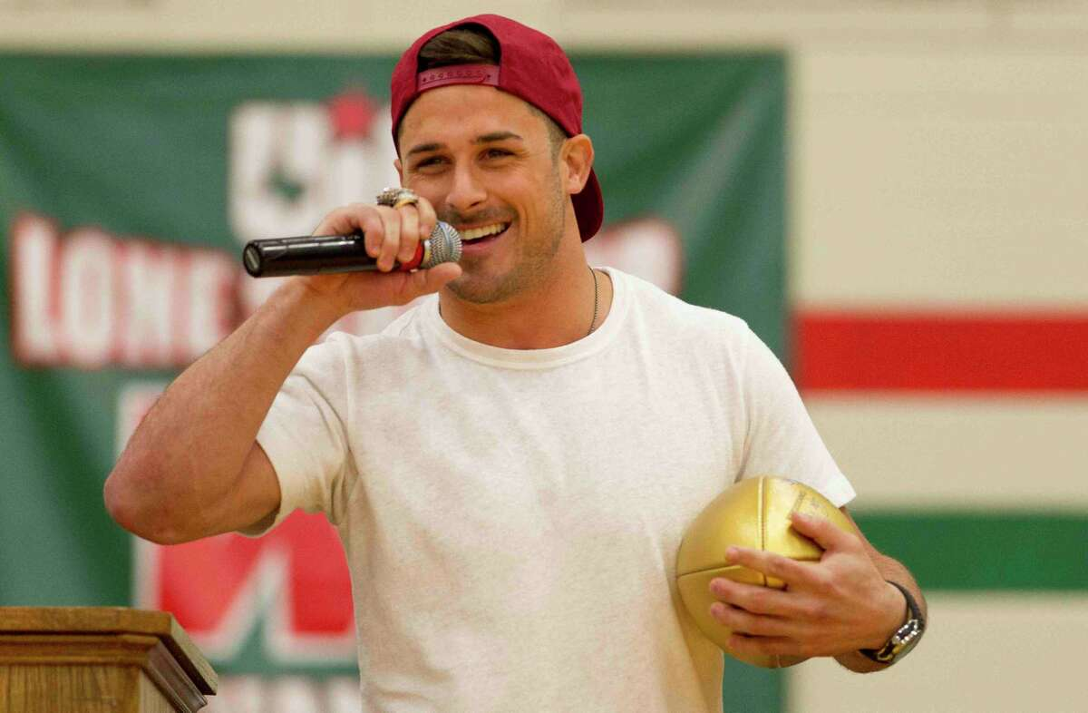 Former Highlander Danny Amendola addresses students during a pep rally at The Woodlands High School in 2017. Amendola joined former Highlanders Lee Johnson and Larry Izzo at the pep rally in celebration of former/current NFL players who have played in the Super Bowl.